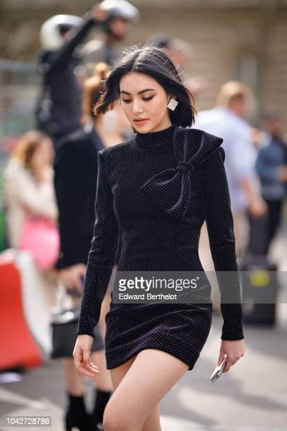 Davika Hoorne wears a black glitter dress outside Balmain during Paris Fashion Week Womenswear Spring/Summer 2019 on September 28 2018 in Paris France