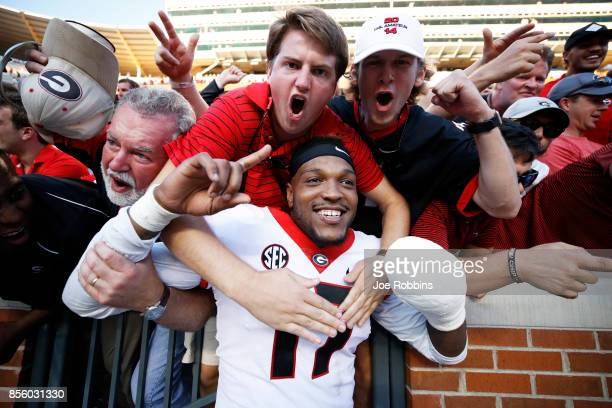 Davin Bellamy of the Georgia Bulldogs celebrates with fans after a game against the Tennessee Volunteers at Neyland Stadium on September 30 2017 in...