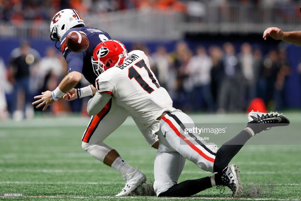 Davin Bellamy #17 of the Georgia Bulldogs forces a fumble by Jarrett Stidham #8 of the Auburn Tigers during the first half in the SEC Championship at Mercedes-Benz Stadium on December 2, 2017 in Atlanta, Georgia.