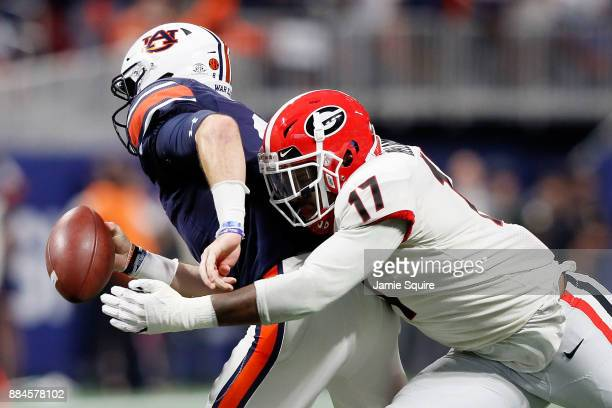 Davin Bellamy of the Georgia Bulldogs forces a fumble by Jarrett Stidham of the Auburn Tigers during the first half in the SEC Championship at...