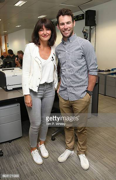 Davina McCall and Mark Cavendish pose for a photo at the BGC Annual Global Charity Day at Canary Wharf on September 12 2016 in London England