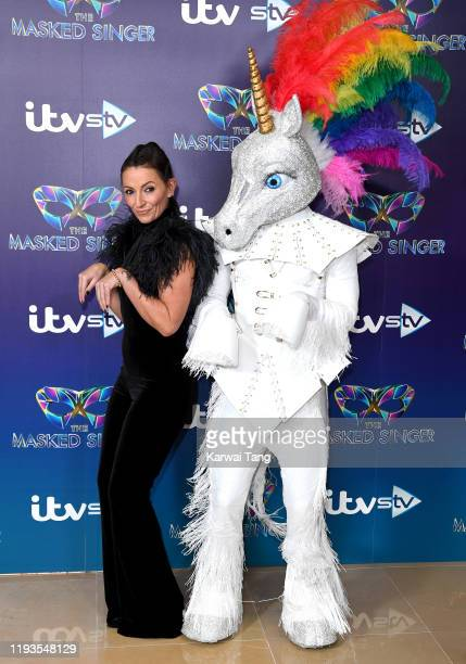 """Davina McCall attends """"The Masked Singer"""" photocall at The Mayfair Hotel on December 12, 2019 in London, England."""