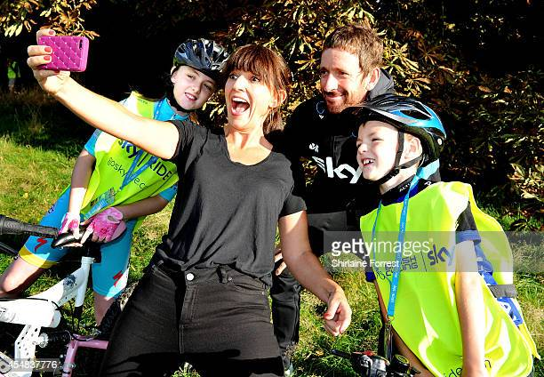 Davina McCall is joined by defending Tour of Britain champion Sir Bradley Wiggins for selfies with young participants at the first ever Sky Ride Big...