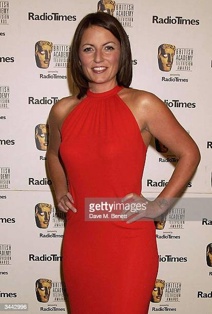 """Davina McCall poses in the pressroom following the """"The British Academy Television Awards"""" at the Grosvenor House Hotel April 18, 2004 in London."""