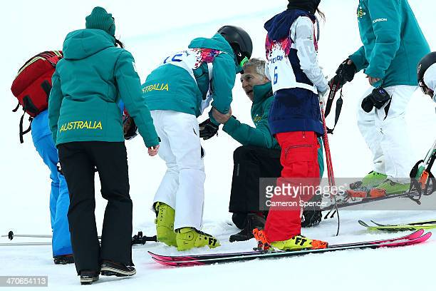 Davina Williams of Australia is attended too by coaching staff and competitors after a fall in practice ahead of the Freestyle Skiing Ladies' Ski...