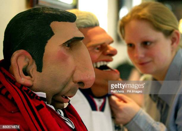 Davina York from Mullock Madeley auctioners puts the final touches to Eric Cantona's and Paul Gasgoine's spitting image puppets one of many items up...