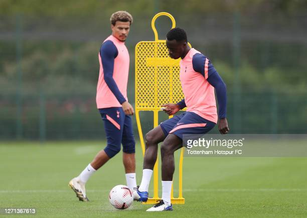 Davinson Sanchez and Dele Alli of Tottenham Hotspur during the Tottenham Hotspur training session at Tottenham Hotspur Training Centre on September...