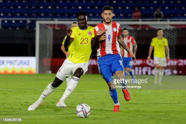 Davinson Sanchez of Colombia fights for the ball with Antonio Sanabria of Paraguay during a match between Paraguay and Colombia as part of South...