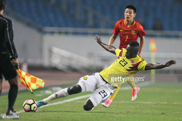Davinson Sanchez of Columbia National Team and Wu Lei of China National Team compete for the ball during the international friendly match between...