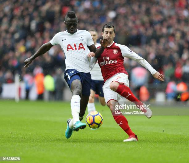 Davinson Sanchez of Tottenham beats Henrikh Mkhitaryan of Arsenal to the ball during the Premier League match between Tottenham Hotspur and Arsenal...