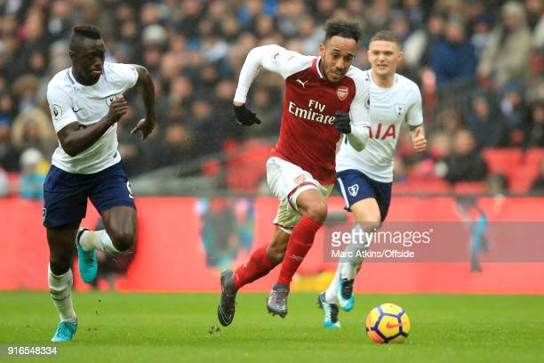 Davinson Sanchez of Tottenham chases PierreEmerick Aubameyang of Arsenal during the Premier League match between Tottenham Hotspur and Arsenal at...