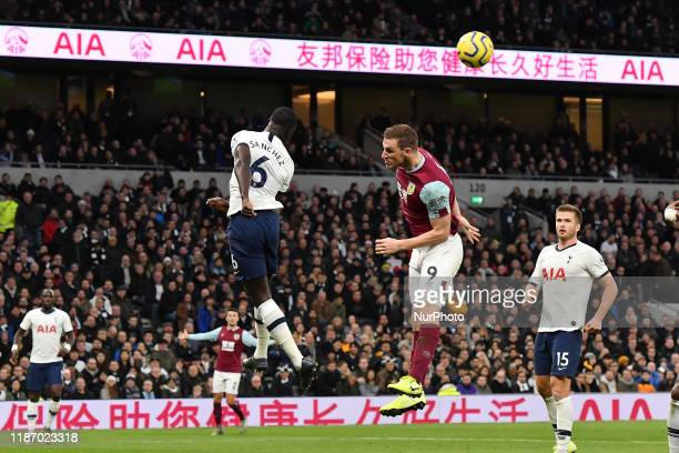 Davinson Sanchez of Tottenham contests a header with Chris Wood of Burnley during the Premier League match between Tottenham Hotspur and Burnley at...