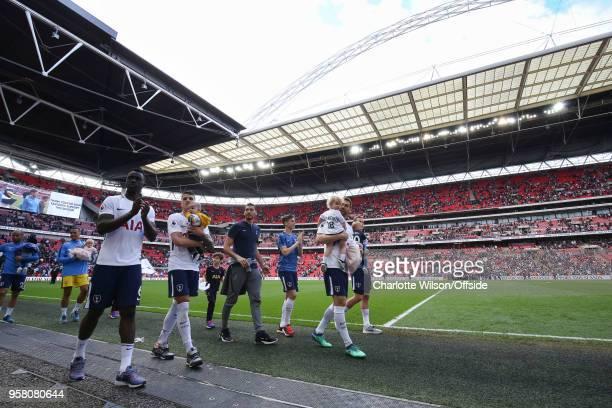 Davinson Sanchez of Tottenham Erik Lamela of Tottenham and Fernando Llorente of Tottenham walk beneath the Wembley arch with their children as they...