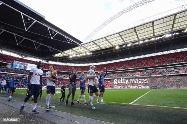 Davinson Sanchez of Tottenham Erik Lamela of Tottenham Fernando Llorente of Tottenham and Harry Kane of Tottenham walk beneath the Wembley arch with...
