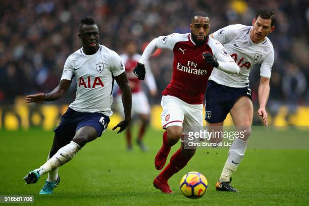 Davinson Sanchez of Tottenham Hotspur and Alexandre Lacazette of Arsenal in action during the Premier League match between Tottenham Hotspur and...