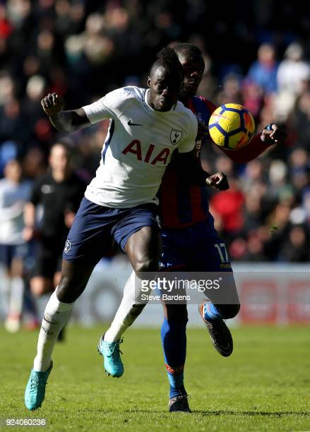 Davinson Sanchez of Tottenham Hotspur and Christian Benteke of Crystal Palace compete for the ball during the Premier League match between Crystal...