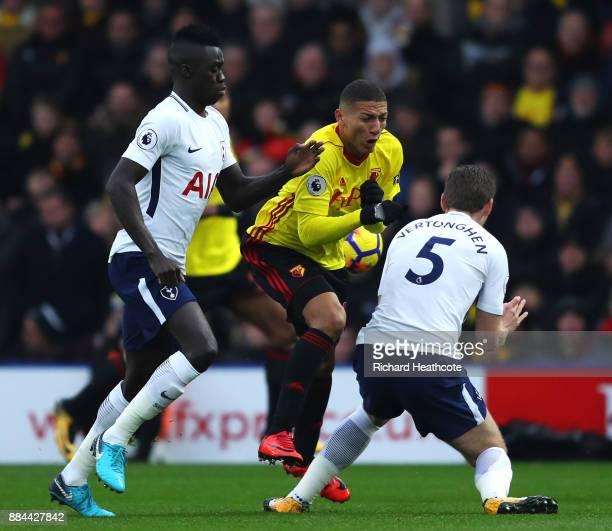 Davinson Sanchez of Tottenham Hotspur and Jan Vertonghen of Tottenham Hotspur challenge Richarlison de Andrade of Watford during the Premier League...