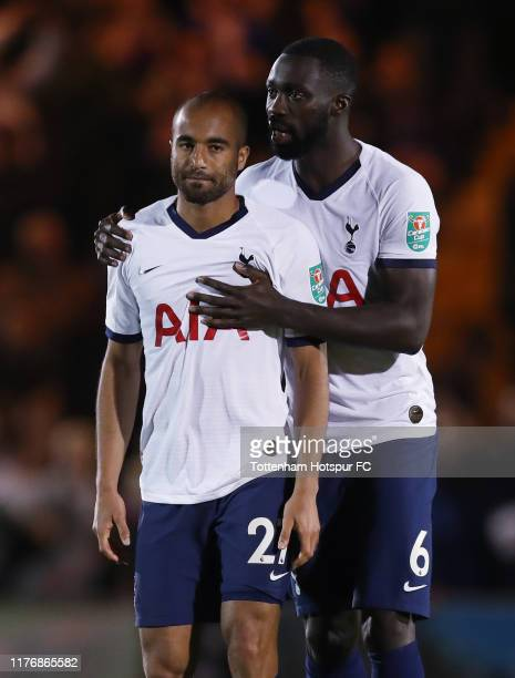 Davinson Sanchez of Tottenham Hotspur consoles Lucas Moura after he misses his penalty in the shootout during the Carabao Cup Third Round match...
