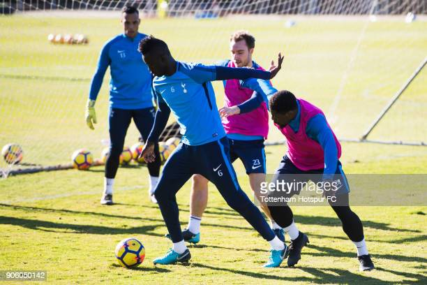 Davinson Sanchez of Tottenham Hotspur controls the ball under pressure from Christian Eriksen and Serge Aurier during a training session during day...