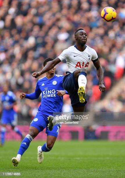 Davinson Sanchez of Tottenham Hotspur controls the ball whilst Demarai Gray of Leicester City looks on during the Premier League match between...