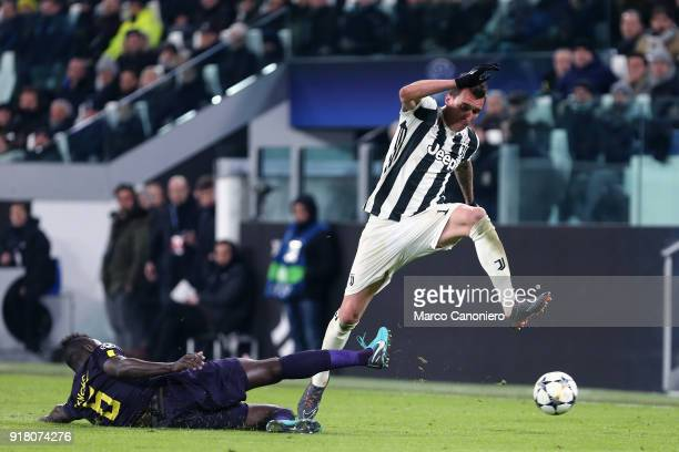 Davinson Sanchez of Tottenham Hotspur Fc and Mario Mandzukic of Juventus Fc in action during the UEFA Champions League round of 16 first leg match...