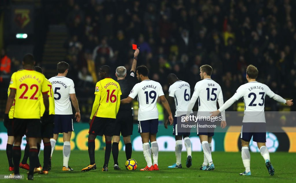 Davinson Sanchez of Tottenham Hotspur is shown a red card by referee Martin Atkinson during the Premier League match between Watford and Tottenham Hotspur at Vicarage Road on December 2, 2017 in Watford, England.
