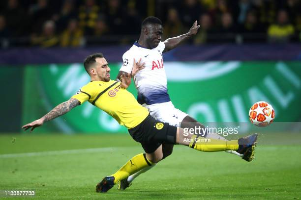 Davinson Sanchez of Tottenham Hotspur is tackled by Paco Alcacer of Borussia Dortmund during the UEFA Champions League Round of 16 Second Leg match...