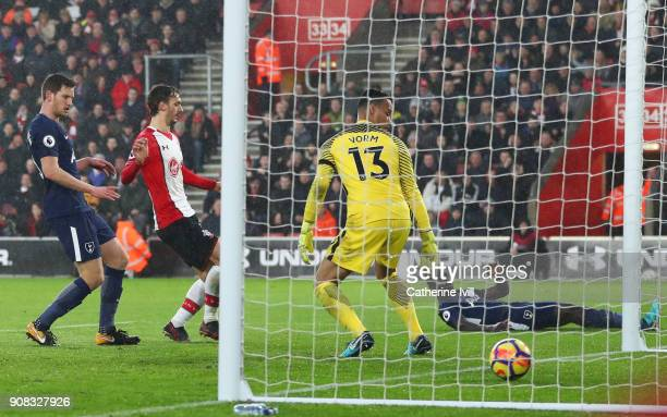 Davinson Sanchez of Tottenham Hotspur looks on as he scores an own goal for Southampton's first goal past Michel Vorm of Tottenham Hotspur during the...