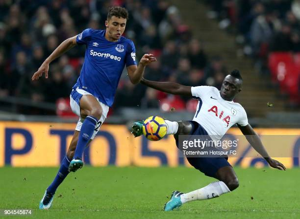 Davinson Sanchez of Tottenham Hotspur tackles Dominic CalvertLewin of Everton during the Premier League match between Tottenham Hotspur and Everton...