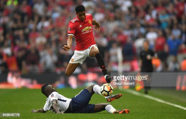 Davinson Sanchez of Tottenham Hotspur tackles Marcus Rashford of Manchester United during The Emirates FA Cup Semi Final match between Manchester...