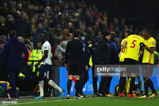 Davinson Sanchez of Tottenham Hotspur walks off after being sent off during the Premier League match between Watford and Tottenham Hotspur at...