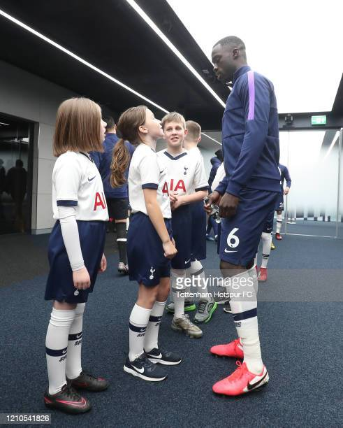 Davinson Sanchez of Tottenham Hotspur with mascots in the tunnel during the FA Cup Fifth Round match between Tottenham Hotspur and Norwich City at...