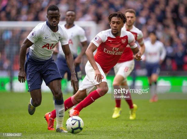 Davinson Sánchez of Tottenham Hotspur and Alex Iwobi of Arsenal during the Premier League match between Tottenham Hotspur and Arsenal FC at Wembley...