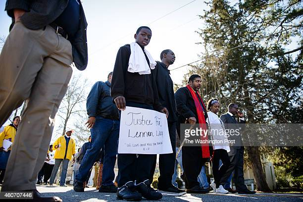 Davion Lacy leads a march with his brother Pierre Lacy NAACP North Carolina chapter president William Barber and his mother Claudia Lacy to honor the...