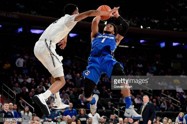 Davion Mintz of the Creighton Bluejays attempts a shot defended by Elias Harden of the Xavier Musketeers in the second half during the Quarterfinals...