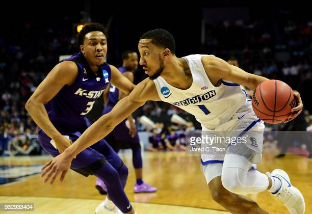 Davion Mintz of the Creighton Bluejays drives against Kamau Stokes of the Kansas State Wildcats during the first round of the 2018 NCAA Men's...