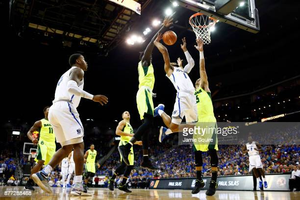 Davion Mintz of the Creighton Bluejays loses the ball as he goes up on a fast break as Jo LualAcuil Jr #0 and Jake Lindsey of the Baylor Bears defend...