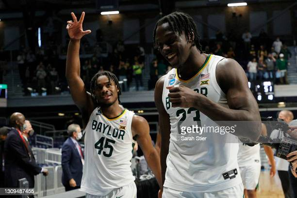 Davion Mitchell and Jonathan Tchamwa Tchatchoua of the Baylor Bears celebrate after defeating the Villanova Wildcats in their Sweet Sixteen game of...