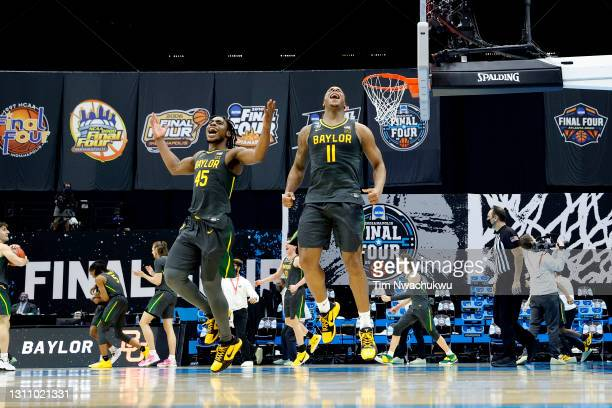 Davion Mitchell and Mark Vital of the Baylor Bears celebrate after winning the National Championship game of the 2021 NCAA Men's Basketball...