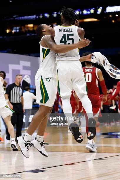 Davion Mitchell of the Baylor Bears and Mark Vital celebrate after defeating the Arkansas Razorbacks in the Elite Eight round of the 2021 NCAA Men's...