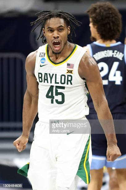 Davion Mitchell of the Baylor Bears celebrates after a play against the Villanova Wildcats in the second half of their Sweet Sixteen game of the 2021...