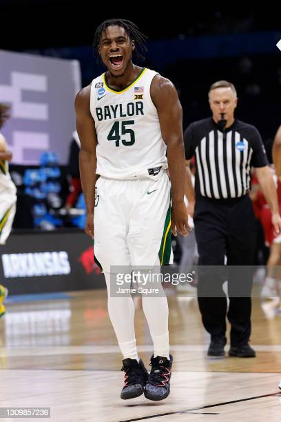 Davion Mitchell of the Baylor Bears celebrates after defeating the Arkansas Razorbacks in the Elite Eight round of the 2021 NCAA Men's Basketball...