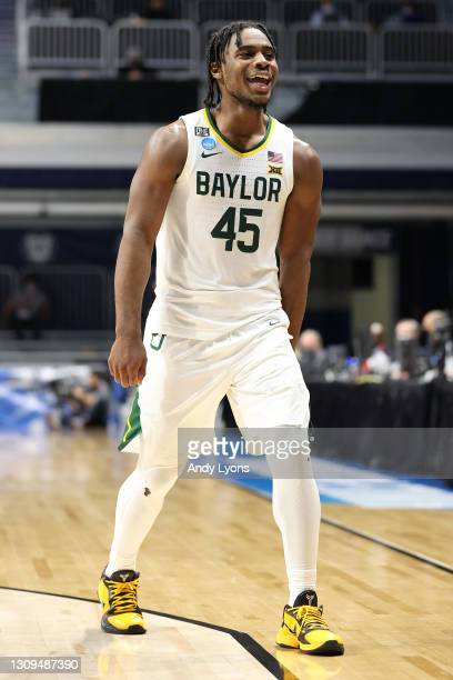 Davion Mitchell of the Baylor Bears celebrates in the final moments of their Sweet Sixteen game against the Villanova Wildcats in the 2021 NCAA Men's...