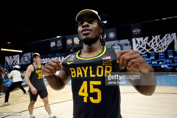 Davion Mitchell of the Baylor Bears celebrates on the court after defeating the Gonzaga Bulldogs 86-70 in the National Championship game of the 2021...