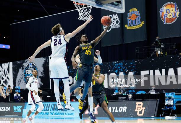 Davion Mitchell of the Baylor Bears goes up for a basket as Corey Kispert of the Gonzaga Bulldogs defends during the National Championship game of...