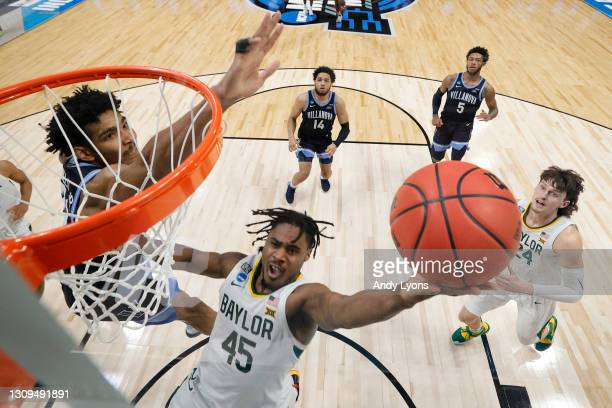 Davion Mitchell of the Baylor Bears goes up for a shot against Jermaine Samuels of the Villanova Wildcats in the second half of their Sweet Sixteen...