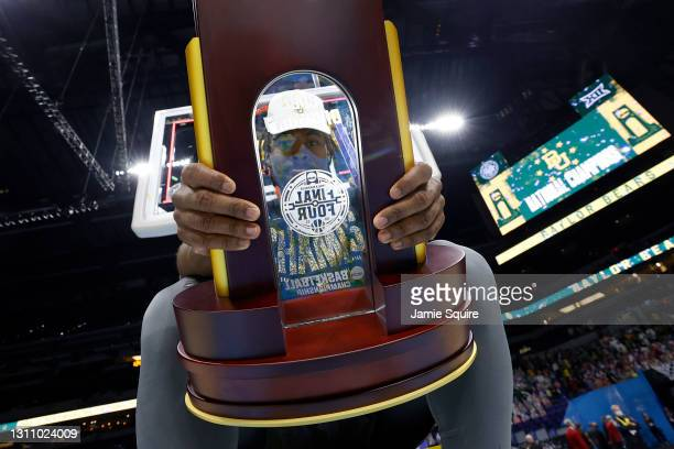 Davion Mitchell of the Baylor Bears holds the trophy after defeating the Gonzaga Bulldogs 86-70 in the National Championship game of the 2021 NCAA...