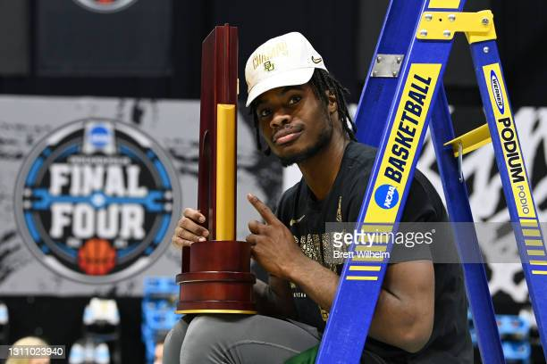 Davion Mitchell of the Baylor Bears poses with the trophy after defeating the Gonzaga Bulldogs in the National Championship game of the 2021 NCAA...