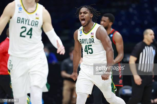 Davion Mitchell of the Baylor Bears reacts to a play against the Hartford Hawks in the first round of the 2021 NCAA Division I Mens Basketball...