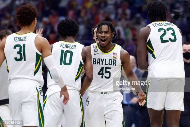 Davion Mitchell of the Baylor Bears reacts with teammates in the first half against the Houston Cougars during the 2021 NCAA Final Four semifinal at...